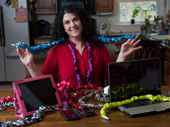 Lisa Lake shows off her Crazy Cord Covers, a product she created to differentiate and hide USB and other device cords.