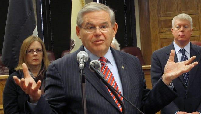 File: Sen. Robert Menendez, D-N.J., speaks at a a public hearing on flood insurance rates, Jan. 2, 2014, in N.J.