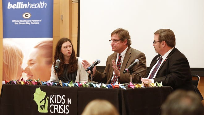 Rep. Paul Tittl (center), sitting between USA TODAY NETWORK-Wisconsin reporter Rory Linnane and Sen. Tim Carpenter, talks about youth mental health at Thursday's Day of Action meeting in Madison.