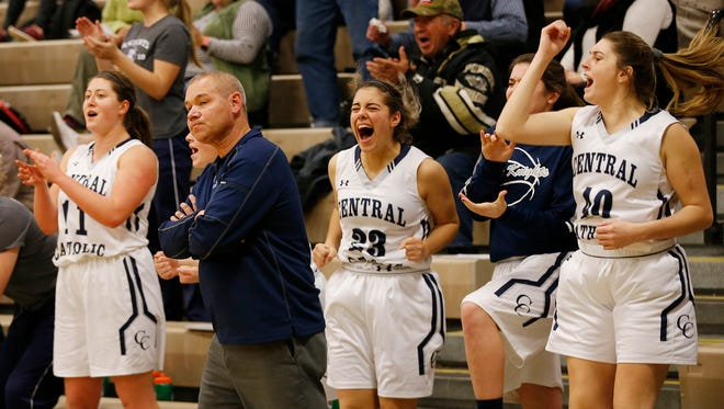 The Central Catholic bench erupts after defeating McCutcheon on Dec. 5. It started a streak where the Knights have won eight of 11 games after a 1-5 start.
