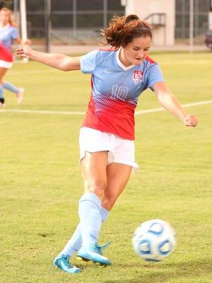 USJ's Sarah Sullivan dribbles the ball against Madison on Aug. 22.