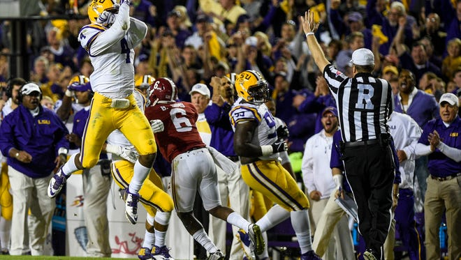 LSU Tigers linebacker Kwon Alexander (4) celebrates a pass breakup during the first half of an NCAA football game against the Alabama Crimson Tide at Tiger Stadium in Baton Rouge, La., Saturday, November 8, 2014.  Paul Kieu, The Advertiser