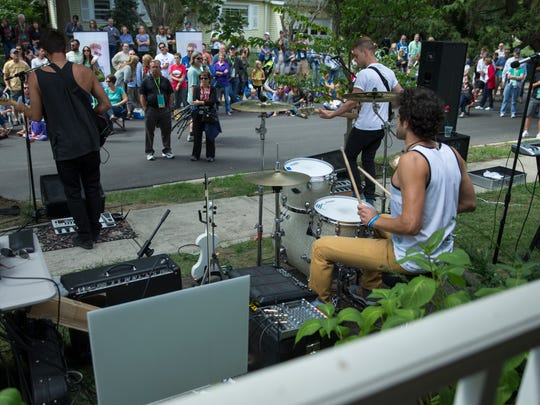 Sam Law performs during the second annual Porchfest, Carmel, Sunday, September 13, 2015. The event features a variety of bands playing on downtown porches and front lawns for a crowd of a few thousand.