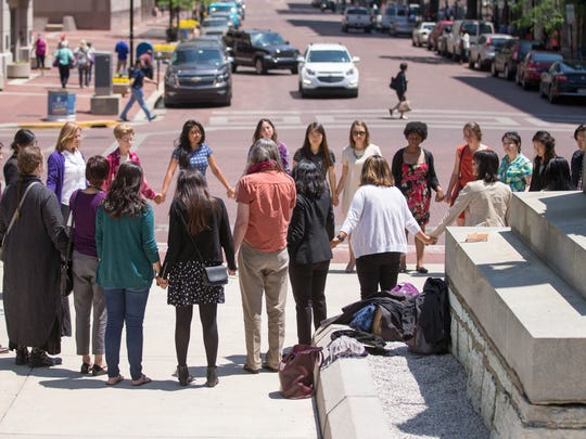 About 30 people, most arriving on a bus from Chicago, formed a circle Monday, May 23, 2016, outside the Indiana Statehouse before sitting in on an appeal by Purvi Patel, a Mishawaka woman sentenced to 20 years for feticide.