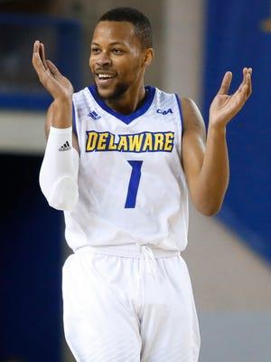 Delaware's Chivarsky Corbett celebrates a Blue Hens run in the first half against Delaware State at the Bob Carpenter Center Friday.
