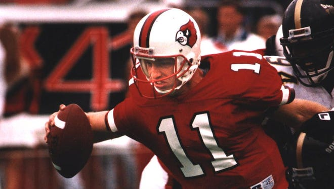 Jeff Brohm, announced as Purdue's new head football coach on Monday, is shown here playing for the University of Louisville.