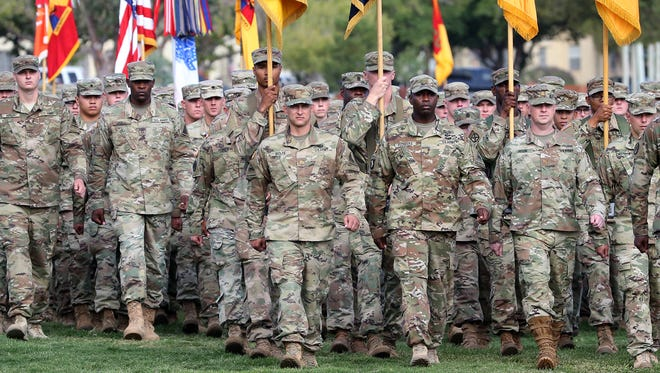 Fort Bliss soldiers pass in review during a change of command ceremony for the commander of the 1st Armored Division and Fort Bliss Thursday on post.