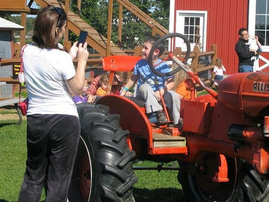 Wickham-tractor-and-kid