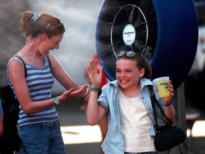 Cassie Hovancak, 12, (left) and Lindsey Greek, 12,