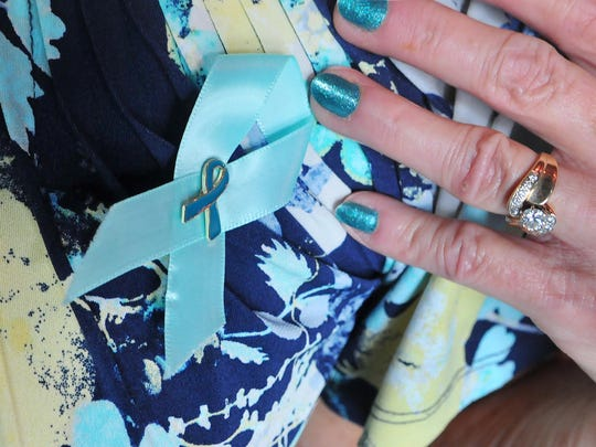 Teal is the official color of ovarian cancer.