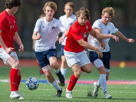 Jackson Prep's Chance Lovertich (15) works for a ball