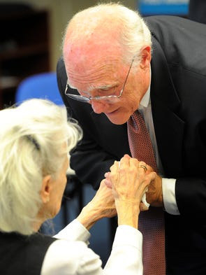 Pulitzer Prize winning investigative journalist Sonny Rawls expresses his condolences to John Seigenthaler's widow, Dolores, during visitation at the First Amendment Center.  Sunday July 13, 2014, in Nashville, TN.