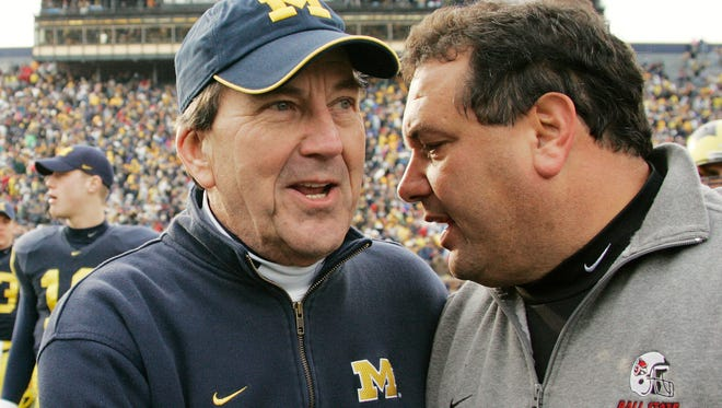 Former Michigan head coach Lloyd Carr is pictured with Brady Hoke in 2006 when Hoke was with Ball State.