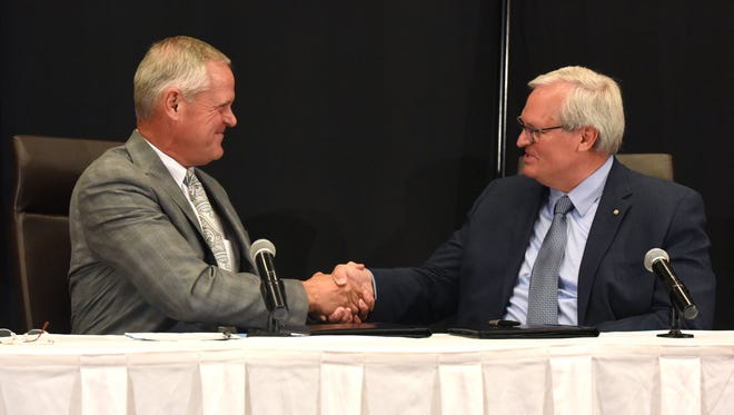 Kelby Krabbenhoft, president and CEO of Sanford Health (left) and David J. Horazdovsky, president and CEO of the Evangelical Lutheran Good Samaritan Society, shake hands during a press conference at the Sheraton Sioux Falls & Convention Center in Sioux Falls, S.D. Tuesday, June 26, 2018.