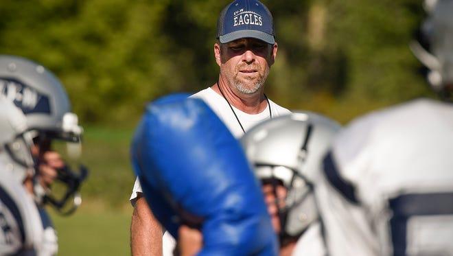 Eden Valley-Watkins coach Jon Thielen watches linemen running blocking drills during practice Wednesday, Aug. 17, in Eden Valley.