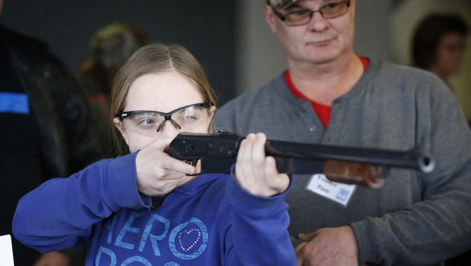Millport resident Rebekah Merrill fires at metal targets with a cork gun at the Big Game Recovery Services booth during the 2016 Twin Tiers Outdoor Expo at First Arena.