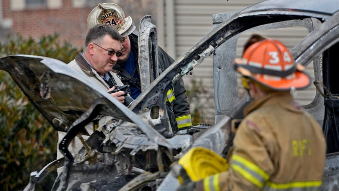 Det. Don Hopple from York Area Regional Police and Red Lion Fire Chief Ben Rodkey investigate a work van fire that extended to the home on Chatham Ln in Windsor Township, Tuesday Jan. 16, 2018, . John A. Pavoncello photo