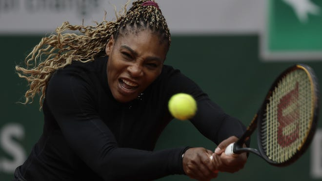 Serena Williams plays a shot against Kristie Ahn during Monday's match.