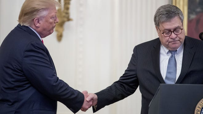 In this Sept. 9 photo, President Donald Trump shakes hands with Attorney General William Barr,as he takes the podium to present the Medal of Valor to six police officers for stopping a mass shooter in Dayton, Ohio, and Heroic Commendations to five civilians for their heroism during the mass shooting in El Paso, Texas, at the White House in Washington.
