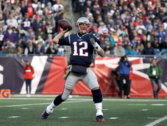 New England Patriots quarterback Tom Brady fires away