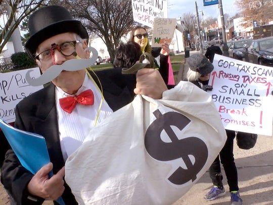 Jim Tobias, Matawan, dresses as 'Mr. Moneybags' as