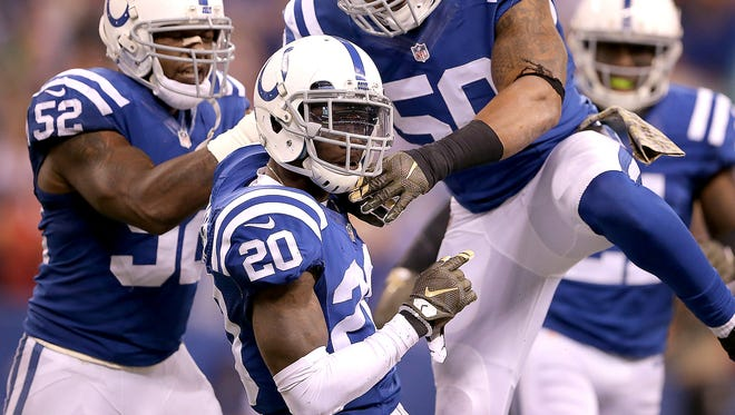 Indianapolis Colts cornerback Darius Butler (20) celebrated with his teammates linebacker Jerrell Freeman (50),right, and linebacker D'Qwell Jackson (52) after intercepting Denver Broncos quarterback Peyton Manning (18) late in the fourth quarter. The Indianapolis Colts defeated the Denver Broncos 27-24 Sunday, November 8, 2015, afternoon at Lucas Oil Stadium.
