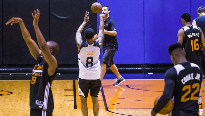 Players shoot during the Phoenix Suns Summer League at Talking Stick Resort Arena in Phoenix, Wednesday, July 6, 2016.
