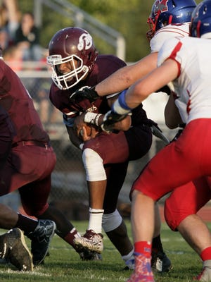 Okemos' Dalis Williams rushes against Mason last season. Williams heads a solid backfield for the Chiefs in 2016.