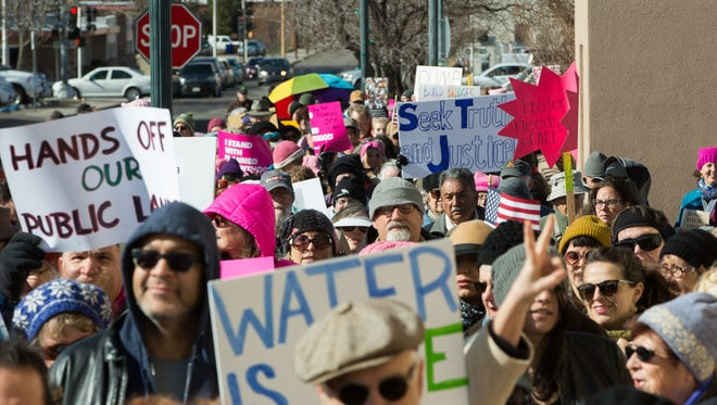 After speeches from many local communities activists, over a thousand people marched through downtown Las Cruces, Saturday January 21, 2017, in solidarity with the marches taking place across the country. Protesters gathered to protest the inauguration of Donald Trump.
