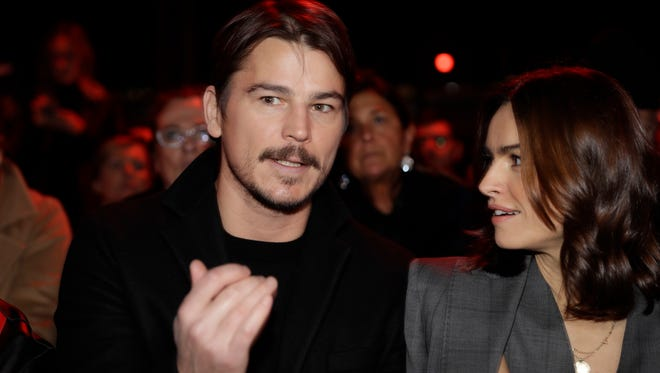 Actor Josh Hartnett, left, speaks with actress Kasia Smutniak prior to the Dsquared2 men's Fall-Winter 2018-19 collection, that was presented in Milan, Italy.