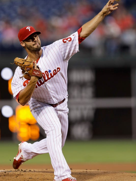 Philadelphia Phillies' Adam Morgan pitches during the first inning of a baseball game against the Washington Nationals, Wednesday, Aug. 31, 2016, in Philadelphia. (AP Photo/Matt Slocum)