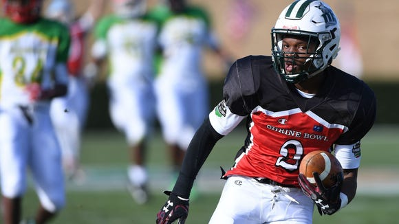 Dutch Fork wide receiver Bryce Thompson, a USC recruit, scores a touchdown for South Carolina in the Sandlappers' 55-24 loss Saturday.