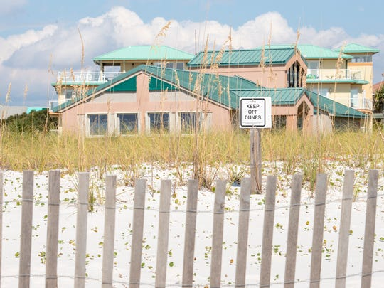 The county has proposed a 30-space parking lot behind the Escambia County Sheriff's Office substation at Casino Beach in Pensacola.  Thursday, September 14, 2017.