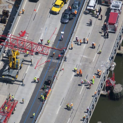 Aerial photo's of a construction crane that has collapsed