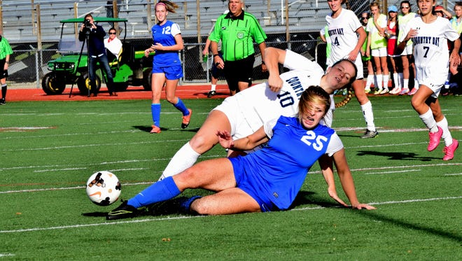 Madeira's Mary Englert (25) makes a sliding tackle to defend against Cincinnati Country Day's shot on goal by Olivia Brown (10), November 5, 2016.