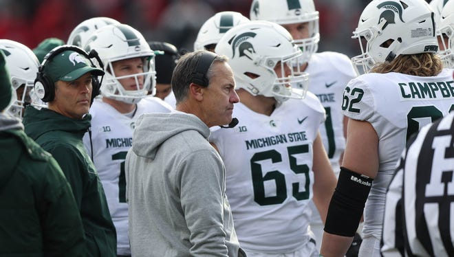 Michigan State coach Mark Dantonio talks with his team during a time-out Saturday, Nov. 11, 2017 at Ohio Stadium in Columbus, Ohio.