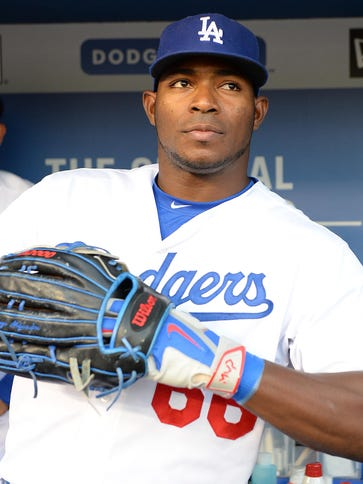 Dodgers right fielder Yasiel Puig in the dugout before