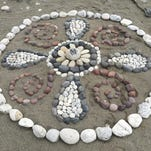 """A pattern of carefully arranged and color-sorted stones form a rainbow trout on a sand bar near Livingston. Most of the works of natural guerilla art measure several feet across. The anonymous artist behind the work is known only as """"Montana Banksy,"""" or """"MB."""""""