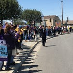 Striking teachers and workers  picket outside the MAOF Mountain Valley  child care center in east Salinas on Tuesday.