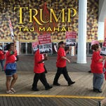 Striking union members walk a picket line outside the Trump Taj Mahal casino in Atlantic City on Friday. Local 54 of the Unite-HERE union went on strike against the casino, which is owned by billionaire investor Carl Icahn.