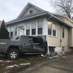 WATCH: Crews remove Chevy Avalanche from house