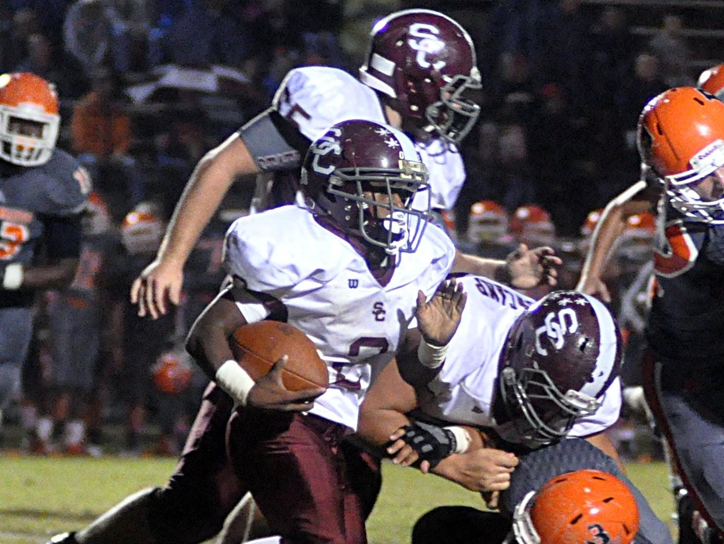 Station Camp High sophomore Kaemon Dunlap carries the ball during second-quarter action.