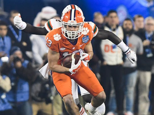 Clemson wide receiver Hunter Renfrow (13)  makes a reception against Miami during the 1st quarter of the ACC championship game against Miami at Bank of America Stadium in Charlotte on Saturday, December 2, 2017.