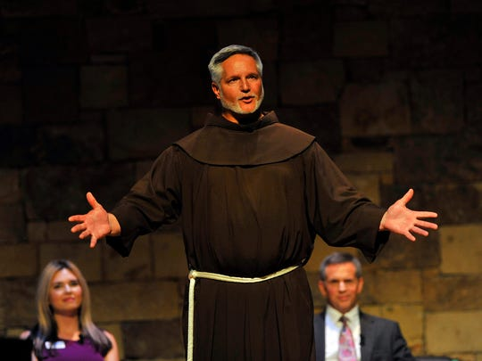 Father Patrick Tuttle of St. Anthony of Padua Catholic Church, speaks during a forum focused on Greenville's 'unseen' at the Kroc Center on Tuesday, June 9, 2015.