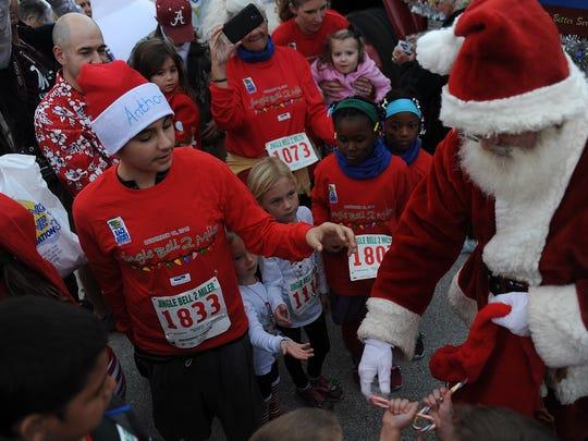 Santa arrives at the Jingle Bell 2-Miler.