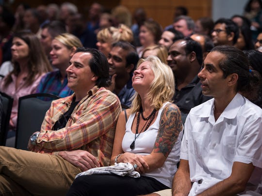 Audience members react as they listen to Sadhguru, an internationally known mystic yogi, founder of Isha and New York Times best-selling author, speak in Nashville recently.