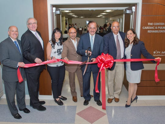Physicians and staff members celebrate the opening