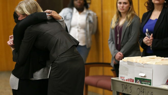 Lentory Johnson hugs Assistant District Attorney Michelle Crowley after the jury came back with a not guilty verdict for Jalen Everett, who was on trial for the second time in connection with the triple homicide on Genesee Street in 2015. Lenore's son Johnny Johnson was one of three people who were killed in the shootings.