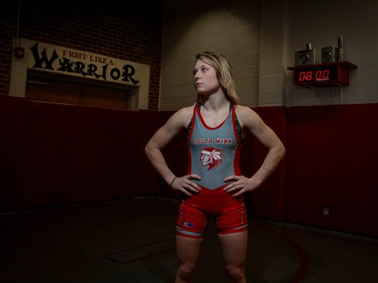 Felicity Taylor, began wrestling as a freshman at South Winneshiek, graduated with more than 100 career prep victories.