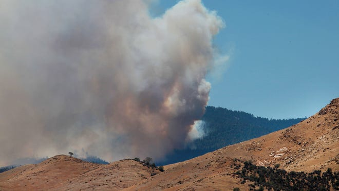 Heavy smoke from the Shirley Fire above Wofford Heights, Calif., is seen Sunday, June 15, 2014.
